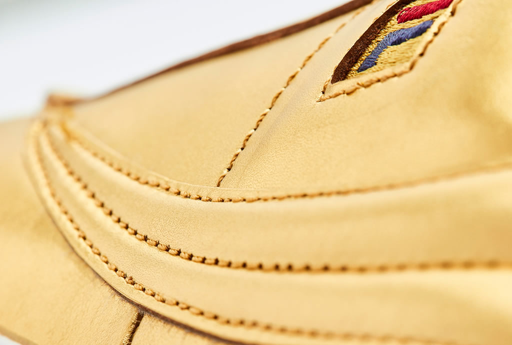 Lavish Looking FILA Original Tennis Sneaker In Gold Leather