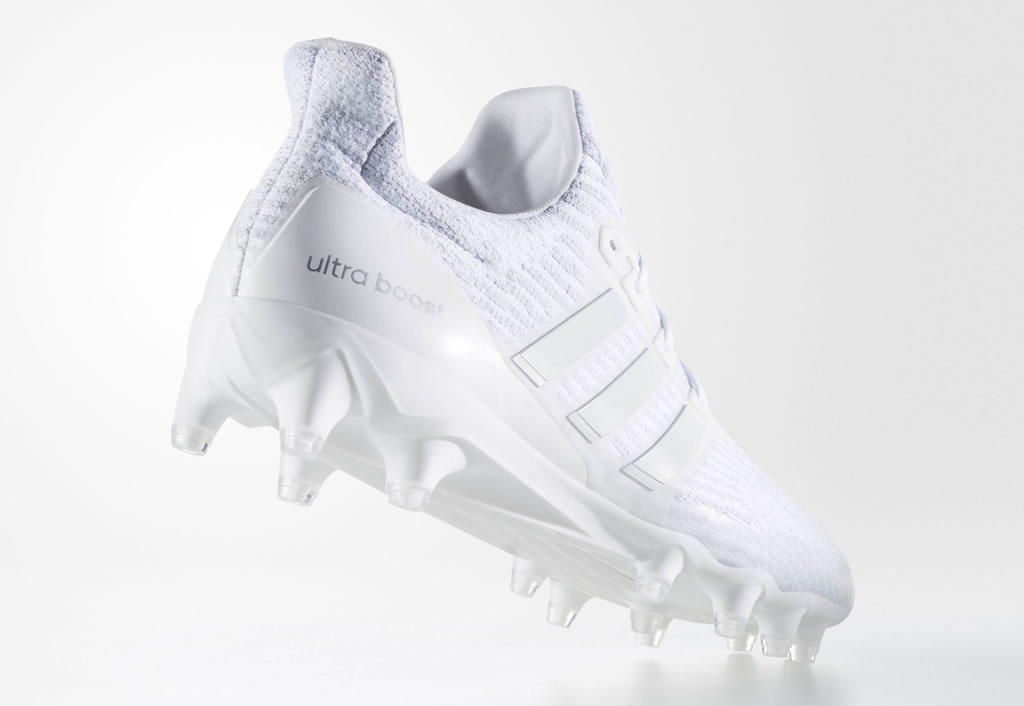 All white Ultraboost football cleats by Adidas